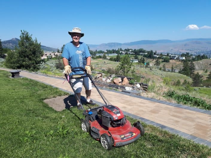 Volunteers - Al mowing our lawn every week